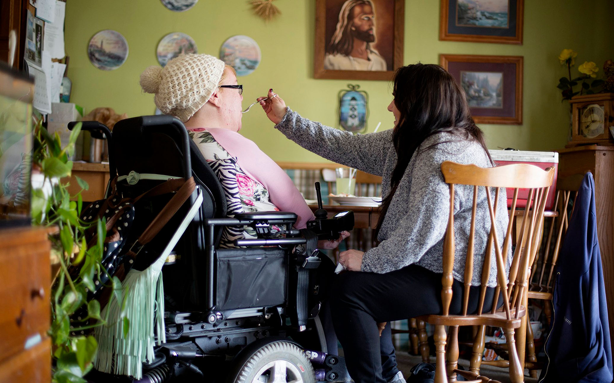 A caregiver assists a woman with a disability. Under a new federal rule, personal care attendants are considered health care workers and have broader rights to refuse to provide services that go against their beliefs. (Courtney Hergesheimer/The Columbus Dispatch/TNS)